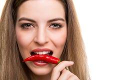 Woman eating pepper Stock Photos