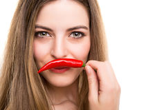 Woman eating pepper Stock Image