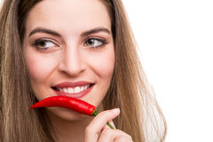 Woman eating pepper Royalty Free Stock Photography