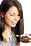 Woman eating piece of cake. Royalty Free Stock Photos