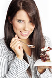 Woman eating piece of cake. Stock Photo