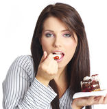 Woman eating piece of cake. Stock Image