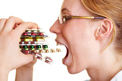 Woman eating pills. Nurse holding many colorful pills in her hands Royalty Free Stock Images