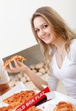 Woman eating pizza Stock Photography