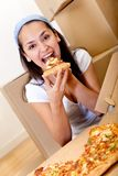 Woman eating pizza Royalty Free Stock Photos