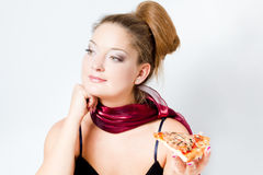 Woman eating pizza Stock Images
