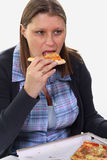 Woman eating pizza, isolated on white Royalty Free Stock Photography