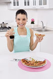 Woman eating pizza Royalty Free Stock Images