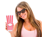 Woman eating popcorn at the movies Royalty Free Stock Photos