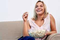 Woman eating popcorn Stock Photo