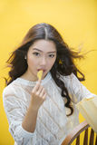 Woman eating potato chips Stock Photos