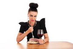Woman eating raw meat with macaroni Stock Image