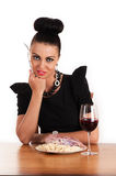 Woman eating raw meat with macaroni Royalty Free Stock Photos