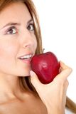 Woman eating a red apple Royalty Free Stock Photo