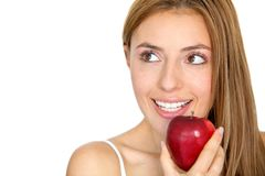 Woman eating a red apple Royalty Free Stock Image
