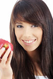 Woman eating red apple. Stock Photos