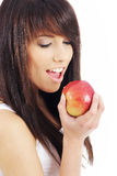 Woman eating red apple. Royalty Free Stock Photography