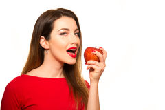 Woman Eating Red Apple Fruit Smiling Isolated on White Backgroun Royalty Free Stock Image
