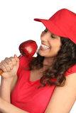 Woman eating a red apple Royalty Free Stock Photography