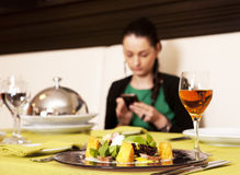 Woman eating at a restaurant. Royalty Free Stock Photo