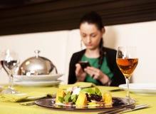 Woman eating at a restaurant. Royalty Free Stock Photo
