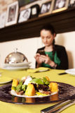 Woman eating at a restaurant. Royalty Free Stock Image