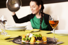 Woman eating at a restaurant. Royalty Free Stock Photos