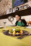 Woman eating at a restaurant. Royalty Free Stock Images