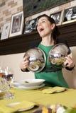 Woman eating at a restaurant. Stock Photos
