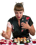 Woman eating rolls Stock Photography