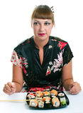 Woman eating rolls Royalty Free Stock Photos