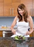 Woman eating a salad Stock Photos