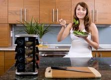 Woman eating a salad Royalty Free Stock Photos
