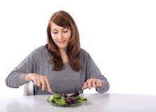 Woman eating a salad Stock Photo