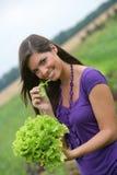 Woman eating a salad. Stock Photos