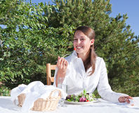 Woman eating salad. Young woman eating a healthy salad outdoors on resturant patio Stock Photos