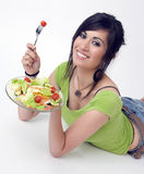 Attractive Woman eating salad healthy green salad Royalty Free Stock Photo