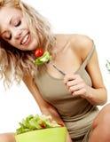 Woman eating salad Stock Image