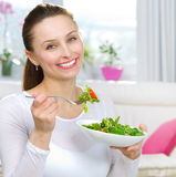 Woman Eating Salad. Diet. Healthy Young Woman Eating Vegetable Salad Stock Image
