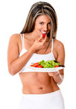 Woman eating a salad Royalty Free Stock Photos