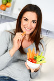 Woman eating salad. Stock Images