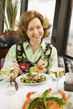 Woman eating salad. Royalty Free Stock Photo