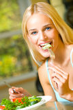 Woman Eating Salad Stock Photography