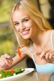 Woman eating salad Royalty Free Stock Photo