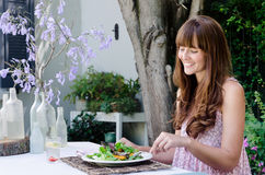 Woman eating salad, alfresco dining Royalty Free Stock Photos