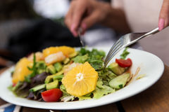 Woman is eating a salad Royalty Free Stock Photo