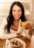 Woman eating salad at home Royalty Free Stock Photography