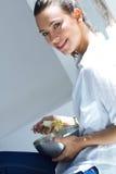 Woman eating salad at home. Beautiful woman eating salad at home Royalty Free Stock Photography