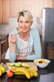 Woman eating salad home Royalty Free Stock Image