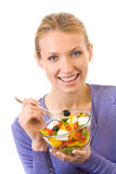 Woman eating salad, isolated Royalty Free Stock Photo